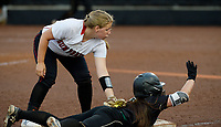 Oshkosh North's Mathena Higgins is safe at third in the top of the fifth inning under the tag of Sun Prairie's Sydney Spatola. Oshkosh North tops Sun Prairie 4-2 in nine innings to win the championship game of the 2019 Division 1 Wisconsin WIAA girls state high school softball tournament on Saturday, June 8, at Goodman Diamond in Madison, Wisconsin