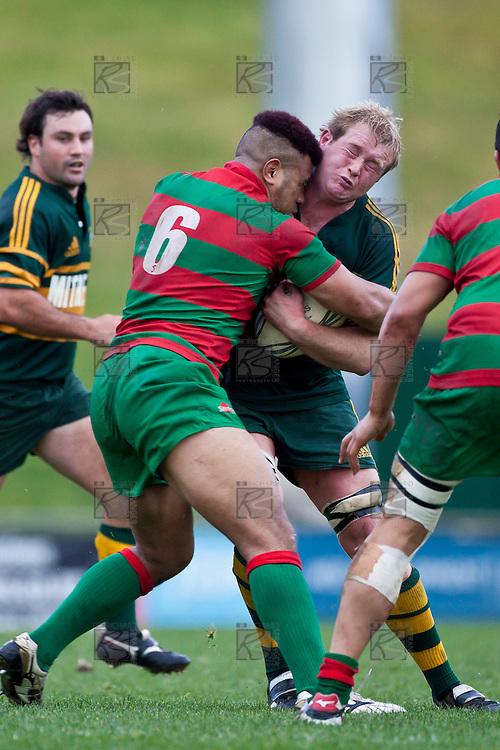 Heads collide as Willie Crisp is hit in a tackle by Tevita Finau.  Counties Manukau McNamara Cup Premier Club Rugby final between Pukekohe andWaiuku, held at Bayer Growers Stadium, on Saturday July 17th. Waiuku won 25 - 20.