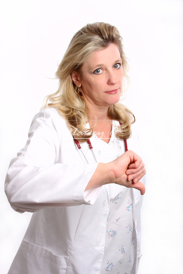 A woman doctor with thumbs down in disapproval