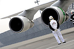 An unnamed Japan Airlines Corp. engineer watches on during an engine test prior to a demonstration flight that utilized sustainable fuel in one engine in Tokyo, Japan.