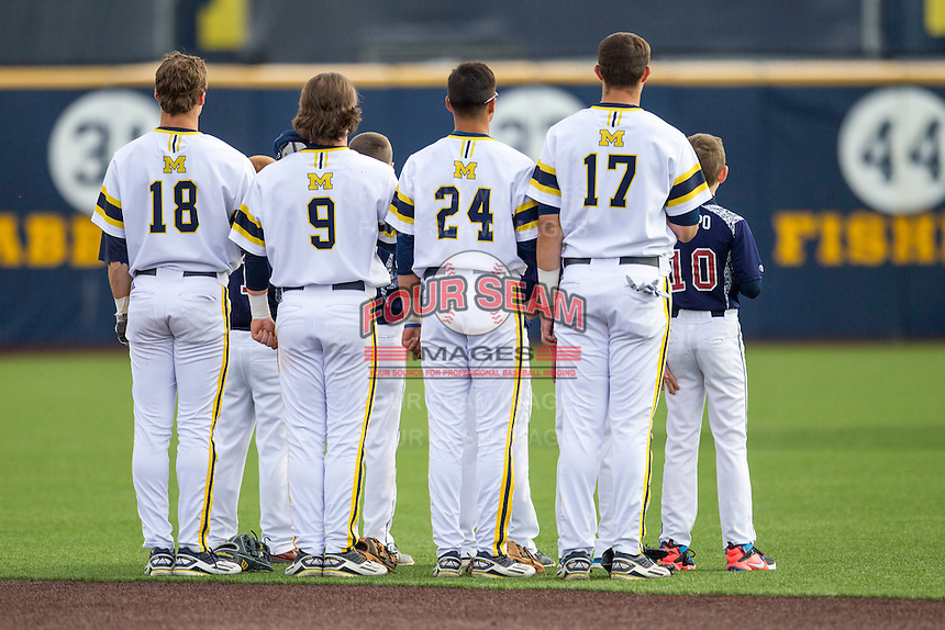 Michigan Wolverines third baseman Jake Bivens (18), shortstop Michael Brdar (9), second baseman Hector Gutierrez (24) and first baseman Drew Lugbauer (17) stand for the national anthem before the game against the Eastern Michigan Hurons on May 3, 2016 at Ray Fisher Stadium in Ann Arbor, Michigan. Michigan defeated Eastern Michigan 12-4. (Andrew Woolley/Four Seam Images)