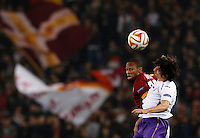 Calcio, Europa League: Ritorno degli ottavi di finale Roma vs Fiorentina. Roma, stadio Olimpico, 19 marzo 2015.<br /> Roma's Seydou Keita, left, and Fiorentina's Stefan Savic jump for the ball during the Europa League round of 16 second leg football match between Roma and Fiorentina at Rome's Olympic stadium, 19 March 2015.<br /> UPDATE IMAGES PRESS/Riccardo De Luca