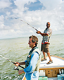 USA, Florida, two men fishing on on a small boat, Ivory Keys