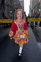 Little Irish Step dancer, Grace Saunders age 5 from Birmingham, England dances up 5th Ave.  246th Saint Patrick's Day Parade,  marches up 5th Avenue,  March 17, 2007.  (© Frances Roberts)