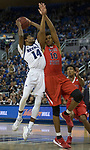 Nevada guard Lindsey Drew (14) shoots over Fresno State forward Orlando Robinson (10) during the first half of a basketball game played at Lawlor Events Center in Reno, Nev., Saturday, Feb. 22, 2020.