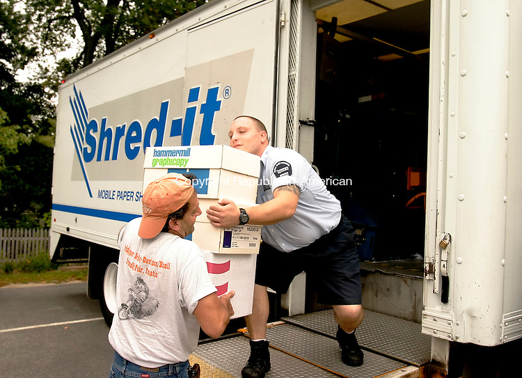 TORRINGTON, CT-- 22 SEPTEMBER 2007--092207JS01-Robert E. Gangloff, a customer service represenatitive for Shred-It, right, takes a some boxes of paper to shred from Gary Graziani of Torrington on Saturday at the LARC parking lot in Torrington. The United Way of Northwest Connecticut hired five trucks placed throughout Litchfield County for residents to shred personal papers. Graziani was getting rid of old papers that had his Social Security number on them. <br /> Jim Shannon / Republican-American