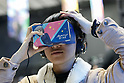A visitor tries out a VR (virtual reality) glasses during the AnimeJapan 2017 at Tokyo Big Sight on March 25, 2017, Tokyo, Japan. AnimeJapan 2017 is a trade show promoting ''Everything Anime'' to local and foreign fans and businesses. The show is held over four-day days with March 23-24 reserved for business visitors and March 25-26 for the public. It is expected to attract some 120,000 visitors, including cosplayers. (Photo by Rodrigo Reyes Marin/AFLO)