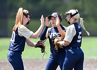 NWA Democrat-Gazette/CHARLIE KAIJO Bentonville West High School players high-five during a softball game, Friday, May 10, 2019 at Tiger Athletic Complex at Bentonville High School in Bentonville. Bentonville West High School defeated Bryant High School 5-3