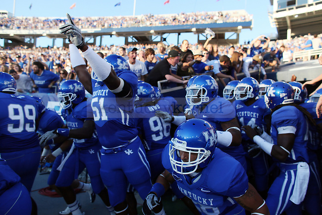 The UK football team takes the field before the first quarter of the UK vs Akron home game on  Saturday, September 18, 2010. Photo by Britney McIntosh | Staff