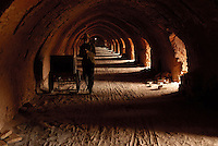 A man walks in a brickkiln in Bazhou, Hebei province, China..04-SEP-04