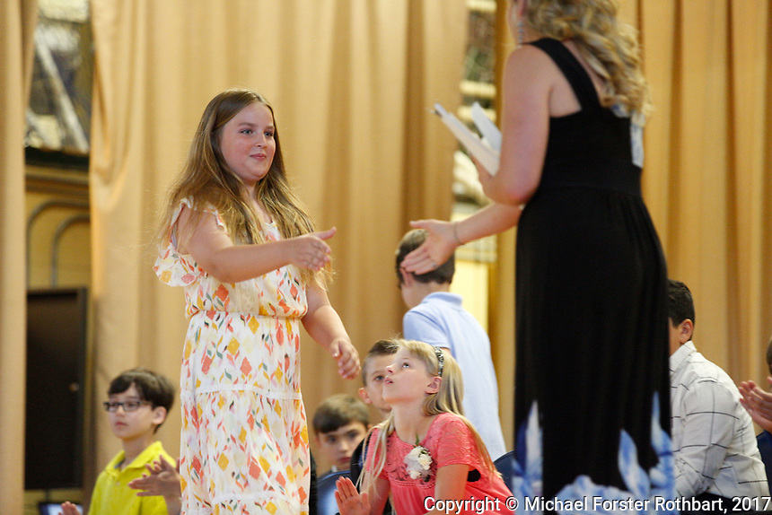 The Oneonta Greater Plains elementary school fifth grade awards ceremony, on June 21, 2017.<br /> &copy; Michael Forster Rothbart Photography<br /> www.mfrphoto.org &bull; 607-267-4893<br /> 34 Spruce St, Oneonta, NY 13820<br /> 86 Three Mile Pond Rd, Vassalboro, ME 04989<br /> info@mfrphoto.org<br /> Photo by: Michael Forster Rothbart<br /> Date:  6/21/2017<br /> File#:  Canon &mdash; Canon EOS 5D Mark III digital camera frame C19134