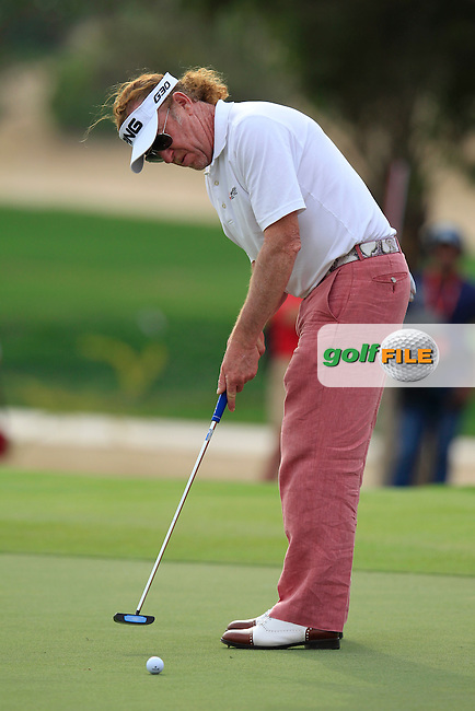 Miguel Angel Jimenez (ESP) putts on the 17th green during Sunday's Final Round of the Abu Dhabi HSBC Golf Championship 2015 held at the Abu Dhabi Golf Course, United Arab Emirates. 18th January 2015.<br /> Picture: Eoin Clarke www.golffile.ie