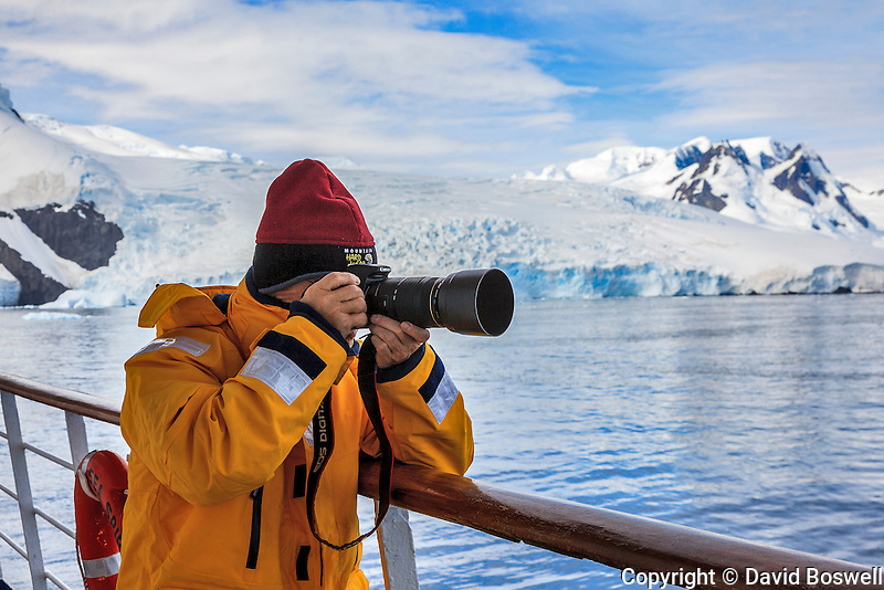 "A photographer capturing the moment aboard the ""Sea Spirit,"" a Quark Expeditions ship, as it sails into Cierva Cove on the coast of the Antarctic Peninsula."