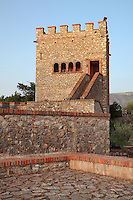 Tower of the Acropolis Castle, reconstructed in the 1930s on the hill of the acropolis, Butrint, Chaonia, Albania. Butrint was founded by the Greek Chaonian tribe and was a port throughout Hellenistic and Roman times, when it was known as Buthrotum. It was ruled by the Byzantines and the Venetians and finally abandoned in the Middle Ages. The ruins at Butrint were listed as a UNESCO World Heritage Site in 1992. Picture by Manuel Cohen