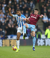 West Ham United's Declan Rice and Huddersfield Town's Steve Mounie<br /> <br /> Photographer Rob Newell/CameraSport<br /> <br /> The Premier League - Huddersfield Town v West Ham United - Saturday 10th November 2018 - John Smith's Stadium - Huddersfield<br /> <br /> World Copyright © 2018 CameraSport. All rights reserved. 43 Linden Ave. Countesthorpe. Leicester. England. LE8 5PG - Tel: +44 (0) 116 277 4147 - admin@camerasport.com - www.camerasport.com