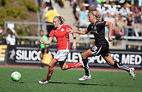 Carrie Dew (19) chases down an attacking Nikki Marhsall (17). FC Gold Pride defeated the Washington Freedom 3-2 at Pioneer Stadium in Hayward, California on July 11th, 2010.