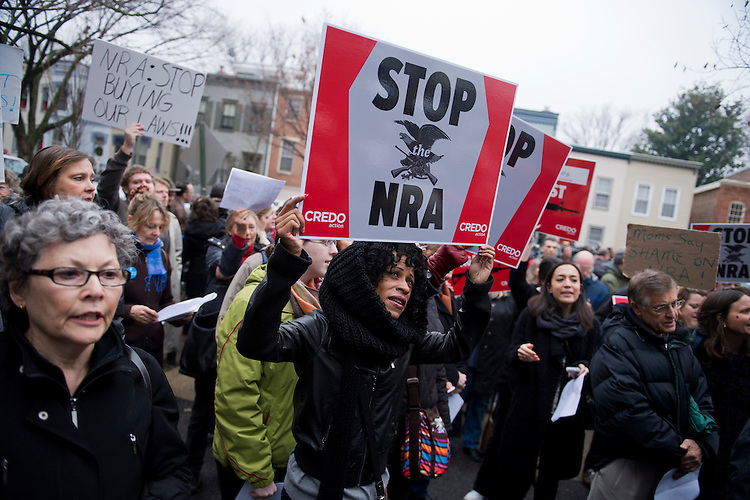UNITED STATES - DECEMBER 17:  Tarsha Devoe, participates in a protest organized by CREDO, outside of the National Rifle Association's office on First St., SE.  The event was organized to criticize NRA policies in the wake of the mass shooting at Sandy Hook Elementary School in Newtown, Conn.  (Photo By Tom Williams/CQ Roll Call)