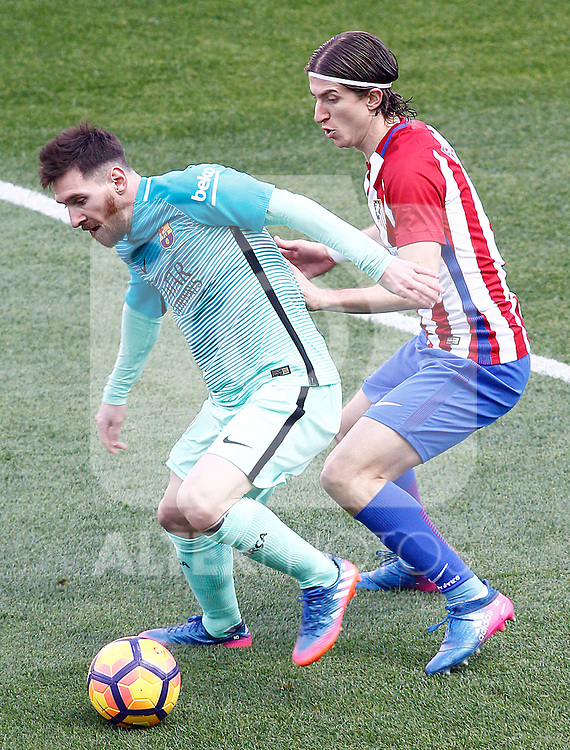 Atletico de Madrid's Filipe Luis (r) and FC Barcelona's Leo Messi during La Liga match. February 26,2017. (ALTERPHOTOS/Acero)