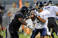 12 August 2011:  FIU's Kenneth Dillard (41) prepares to sack Loranzo Hammonds Jr. (8) during a scrimmage held as part of the FIU 2011 Panther Preview at University Park Stadium in Miami, Florida.