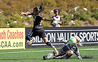 Marta shoots against Val Henderson. FC Gold Pride defeated the Philadelphia Independence 4-0 to win the 2010 WPS Championship at Pioneer Stadium in Hayward, California on September 26th, 2010.