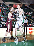 North Texas Mean Green center Ben Knox (15) gets a rebound in the game between the Texas State Bobcats and the University of North Texas Mean Green at the North Texas Coliseum,the Super Pit, in Denton, Texas. UNT defeated Texas State 85 to 62