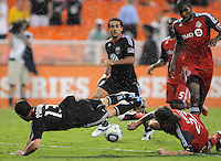 DC United midfielder Chris Pontius (13) gets fouled by Toronto FC midfielder Torsten Frings (22) DC United tied Toronto FC 3-3 at RFK Stadium, Saturday August 6 , 2011.