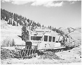 RGS Goose #7 working on scrapping operation at Montelores with rails on flat car.  Note the large piles of spikes and splice bars.<br /> RGS  Montelores, CO  Taken by Richardson, Robert W. - 9/19/1952