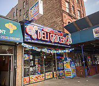 A delicatessen in the neighborhood of Harlem in New York on Sunday, August 9, 2015. (© Richard B. Levine)