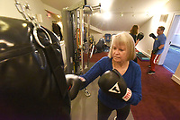 NWA Democrat-Gazette/FLIP PUTTHOFF <br /> Sheryl Morelan (cq) works out Dec. 5 2018 at Rock Steady Boxing in Rogers.