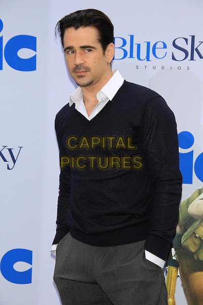 Colin Farrell.attending the New York film premiere of 'Epic' at the Ziegfeld Theatre, New York, NY, May 18th, 2013..half length black jumper sweater shirt v-neck grey gray trousers hands in pockets .CAP/LNC/TOM.©TOM/LNC/Capital Pictures.