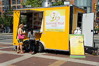 Two women ordering at a Vegan food truck, Vancouver, British Columbia, Canada