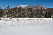 Mount Carrigain from near the the Sawyer River Trail in Livermore, New Hampshire during the winter months. This area was logged during the Sawyer River Railroad era (1877-1928), and the Sawyer River Trail follows part of the railroad bed. Mount Carrigain is a popular day hike.
