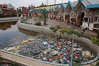 Rubbish is left in a swimming pool in front of a restaurant in Kunming, China. The Yunnan Environmental Protection Bureau has announced that Kunming will be the host city for the China Environmental Protection and Renewable Energy Exposition on raising public awareness about environmental protection..26 Jun 2007