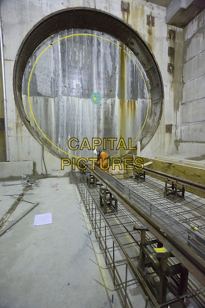 Preparations at Canary Wharf Station box for arrival of tunnelling machines.Crossrail workers are making good progress on building 26 miles (42km) of tunnels beneath the capital. .The new Crossrail route includes a 26 mile (42km) section of tunnels beneath London. Five huge tunnelling machines are now in operation in west, east and southeast London with over 5.5 miles (9km) of tunnels now built.  Tunnelling is also well underway beneath central London station sites using Sprayed Concrete Lining 'mining' techniques to create a further 7.5 miles (12km) of platform tunnels and cross passages..Crossrail's construction commenced on 15 May 2009 at Canary Wharf..The total funding envelope available to deliver Crossrail is £14.8bn. The Crossrail route will pass through 37 stations and run 118 km (73 miles) from Maidenhead and Heathrow in the west, through new twin-bore 21 km (13 miles) tunnels below central London to Shenfield and Abbey Wood in the east..When Crossrail opens it will increase London's rail-based transport network capacity by 10%, supporting regeneration and cutting journey times across the city. Crossrail services are due to commence through central London in 2018. .Crossrail is being delivered by Crossrail Limited (CRL). CRL is a wholly owned subsidiary of Transport for London. Crossrail is jointly sponsored by the Department for Transport and Transport for London.. *Editorial Use Only*.gv general view.CAP/PLF.Image supplied by Capital Pictures