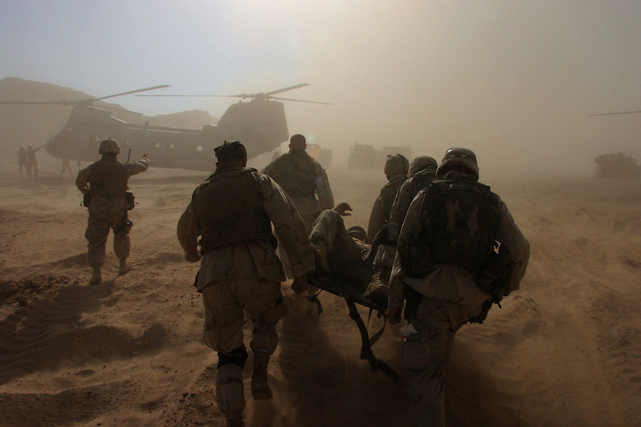The Marines of Charlie Company 1st BN 4th Marines assault the outskirts of Najaf's Old City in preparation for the final push on the Imam Ali Shrine held by fighters from the Moqtada al-Sadr-led Mehdi Army during the Battle of Najaf on August 26, 2004.<br />