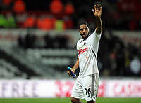 Pictured: Kemy Agustien of Swansea waving to supporters after the final whistle. Tuesday 27 December 2011<br /> Re: Premier League football Swansea City FC v Queens Park Rangers at the Liberty Stadium, south Wales.