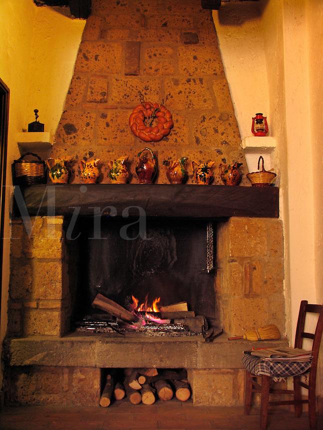 Open hearth cooking fire in restaurant in the Etruscan hilltown of Civita di Bagnoregio, Ital