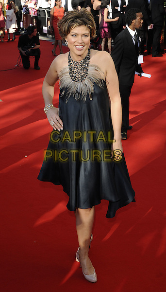 KATE SILVERTON.Arrivals at the British Academy Television Awards 2009, Royal Festival Hall, London, England. .April 26th 2009 .TV Baftas bafta's full length feather grey gray beige dress hand on hip halterneck .CAP/CAN.©Can Nguyen/Capital Pictures.