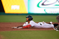Lansing Lugnuts DJ Neal (7) slides into second base during a Midwest League game against the Burlington Bees on July 18, 2019 at Cooley Law School Stadium in Lansing, Michigan.  Lansing defeated Burlington 5-4.  (Mike Janes/Four Seam Images)