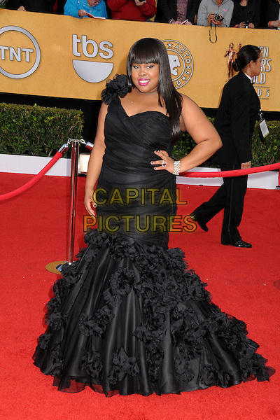 AMBER RILEY.17th Annual Screen Actors Guild Awards held at The Shrine Auditorium, Los Angeles, California, USA..January 30th, 2011.arrivals black one shoulder dress fishtail frills hand on hip full length.CAP/ADM/BP.©Byron Purvis/AdMedia/Capital Pictures.