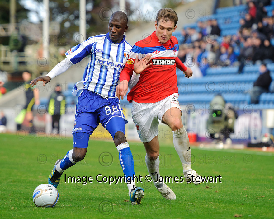 KILMARNOCK'S MOMO SISSOKO TRIES TO GET AWAY FROM RANGERS' NIKICA JELAVIC