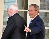 Washington, DC - March 5, 2008 -- United States President George W. Bush, right, gestures to a reporter after making a statement in the Rose Garden of the White House endorsing United States Senator John McCain (Republican of Arizona), left, the presumptive 2008 Republican nominee for President of the United States on Wednesday, March 5, 2008..Credit: Ron Sachs / CNP
