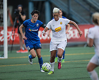 Seattle, WA - Saturday July 16, 2016: Keelin Winters, Lianne Sanderson during a regular season National Women's Soccer League (NWSL) match between the Seattle Reign FC and the Western New York Flash at Memorial Stadium.