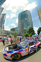 For several days leading up to the May races at the Lowe's Motor Speedway, uptown Charlotte streets are transformed into a showcase of motor sports and non-stop entertainment. ..Photo taken in 2007. Photographer also has images from 2008.