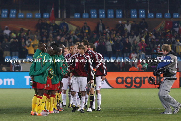 19 JUN 2010: Starting elevens shake hands, pregame. The Denmark National Team defeated the Cameroon National Team 2-1 at Loftus Versfeld Stadium in Tshwane/Pretoria, South Africa in a 2010 FIFA World Cup Group E match.