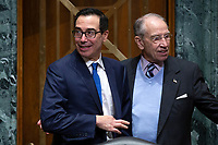 United States Secretary of the Treasury Steven T. Mnuchin greets United States Senator Chuck Grassley (Republican of Iowa) as he arrives to testify before the U.S. Senate Committee on Finance regarding the budget for fiscal year 2021 at the United States Capitol in Washington D.C., U.S. on Wednesday, February 12, 2020.  <br /> <br /> Credit: Stefani Reynolds / CNP/AdMedia