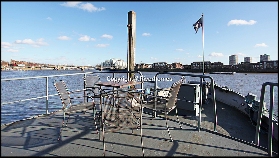 BNPS.co.uk (01202 558833)<br /> Pic: Riverhomes/BNPS<br /> <br /> Al fresco in the heart of ....Chelsea.<br /> <br /> Heart of Lightness - Tardis like houseboat on the Thames.<br /> <br /> A houseboat that looks more like a luxurious penthouse suite inside has gone on the market for a whopping &pound;1.5 million - because it's in one of London's most exclusive locations.<br /> <br /> The 100ft vessel was once a former Dutch barge taking supplies up and down the Thames until it was retired from service in the 1960s and left to rot.<br /> <br /> But a decade later it was salvaged and turned into a houseboat before undergoing a complete refurbishment four years ago and moved to a premier mooring alongside one the swankiest addresses in the city.<br /> <br /> The plush houseboat, berthed at the entrance to Cheyne Walk, now boasts a lavish living room, stylish 50ft-long kitchen, a spiral staircase, two opulent bedrooms, three bathrooms and even a sun terrace.<br /> <br /> And despite its eye-watering &pound;1.5m asking price, experts at Riverhomes estate agents say the houseboat is actually a bargain and that anyone wanting to live in such luxury in the heart of Chelsea would have to shell out many millions more.