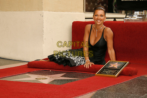 VANESSA L. WILLIAMS.Vanessa Williams Celebrates Her Birthday With a Star On The Hollywood Walk of Fame, Holllywood, California, USA..March 19th, 2007 .full length black dress floral print sitting cleavage .CAP/ADM/RE.©Russ Elliot/AdMedia/Capital Pictures