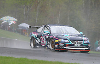 The #23 Pontiac GTO of Kris Szekeres, Mike Weinberg and Frank Del Vecchio races through the rain at the 6 Heueres du Circuit Mont-Tremblant in Mont-Tremblant, Qubec, Canada, on Saturday, May 21, 2005. (Photo by Brian Cleary/www.bcpix.com)