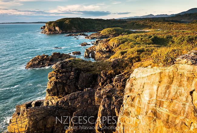 Sunset over Constant Bay in Charleston near Westport, Buller Region, West Coast, New Zealand, NZ